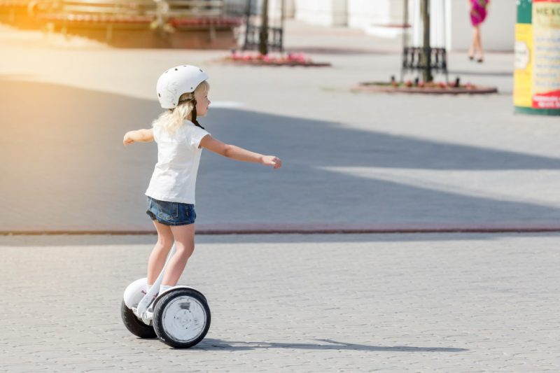 Cute kid on an electric self-balancing scooter