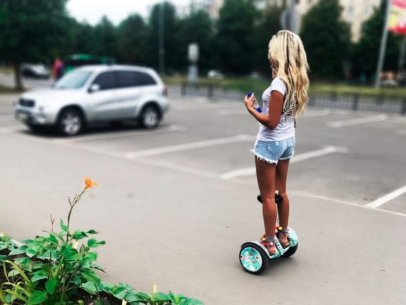 Young woman riding a hoverboard
