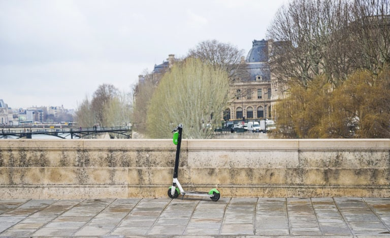 A Lime scooter on an empty street in Paris