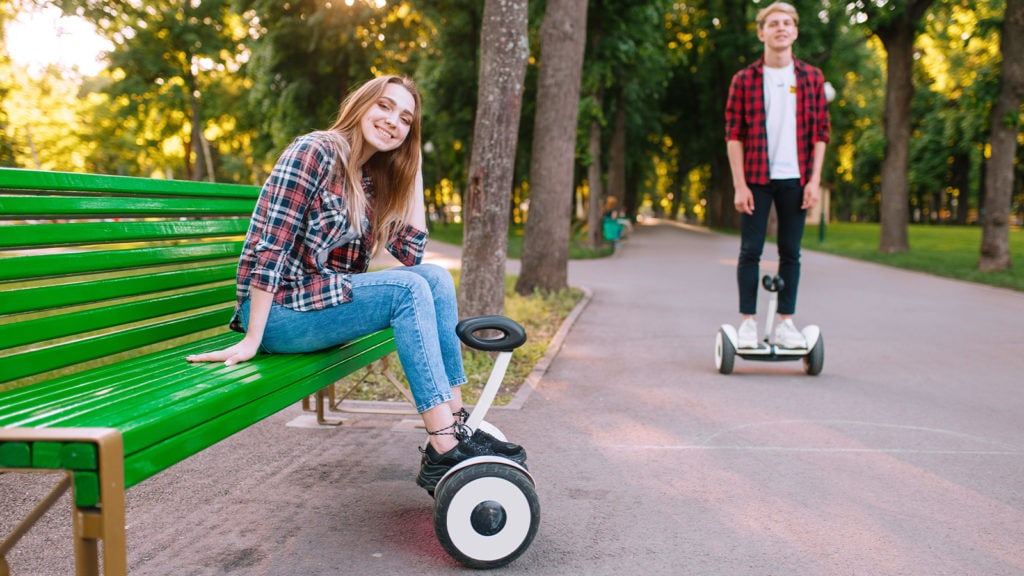 Boy and girl riding self balancing scooters