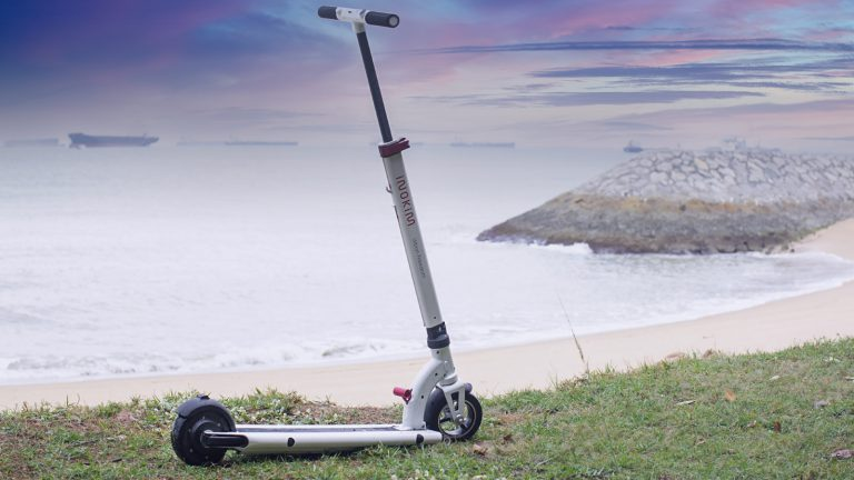 INOKIM Mini 2 electric scooter by the sea