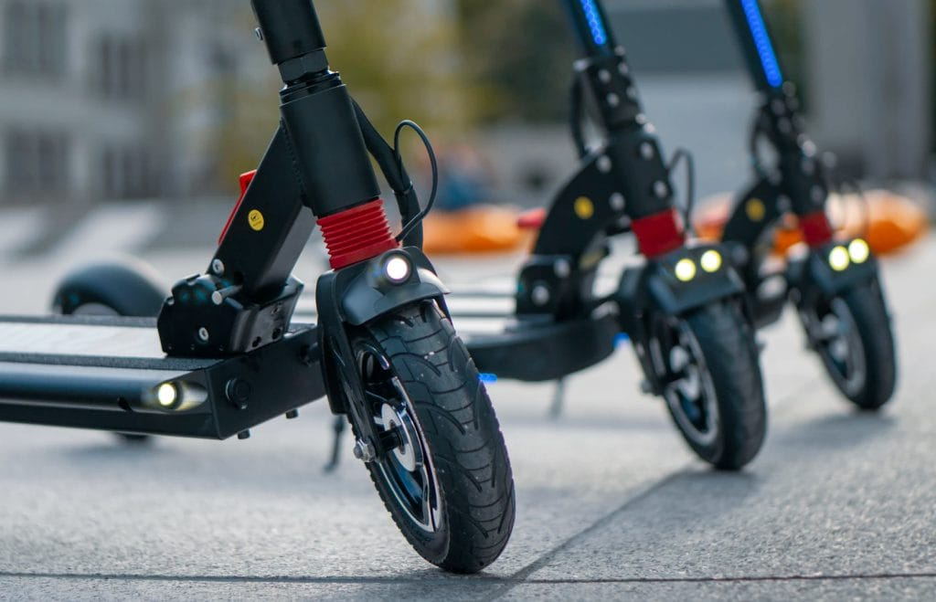 Three ZERO 8 electric scooters on a row