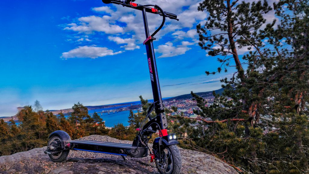 ZERO 9 electric scooter on a big rock with a scenic view in the background