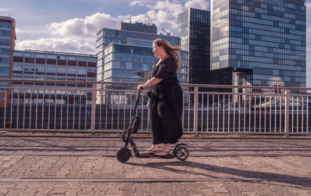 overweight woman riding on an electric scooter