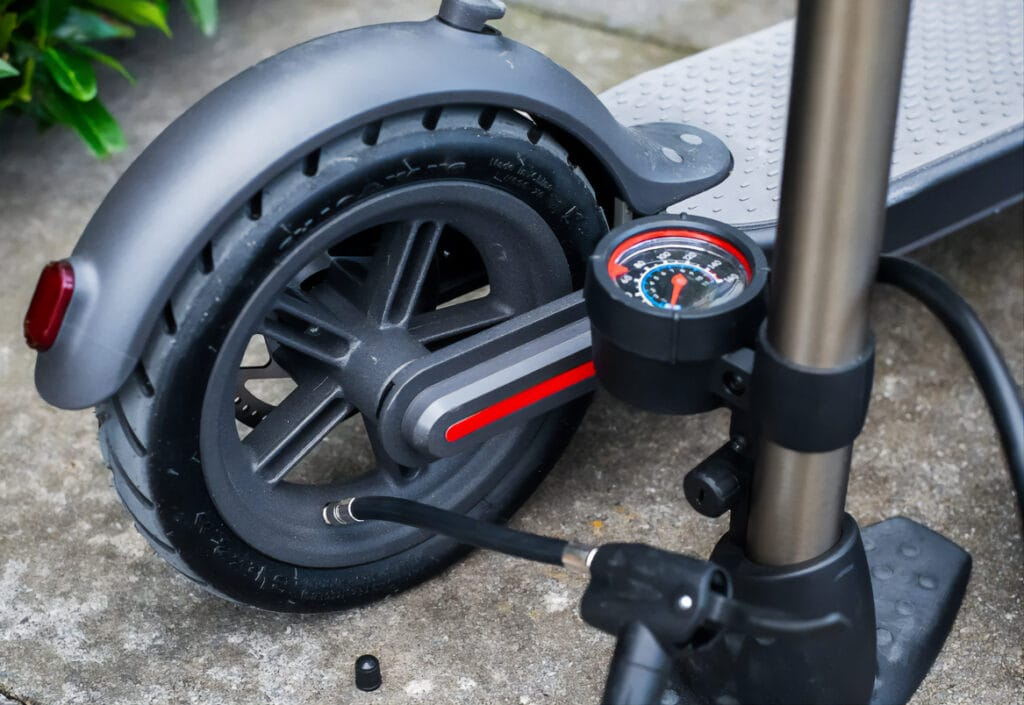 electric scooter tires getting pumped up
