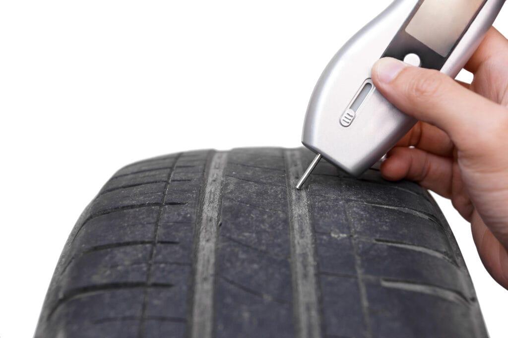 low tire tread check with a digital tread depth tool
