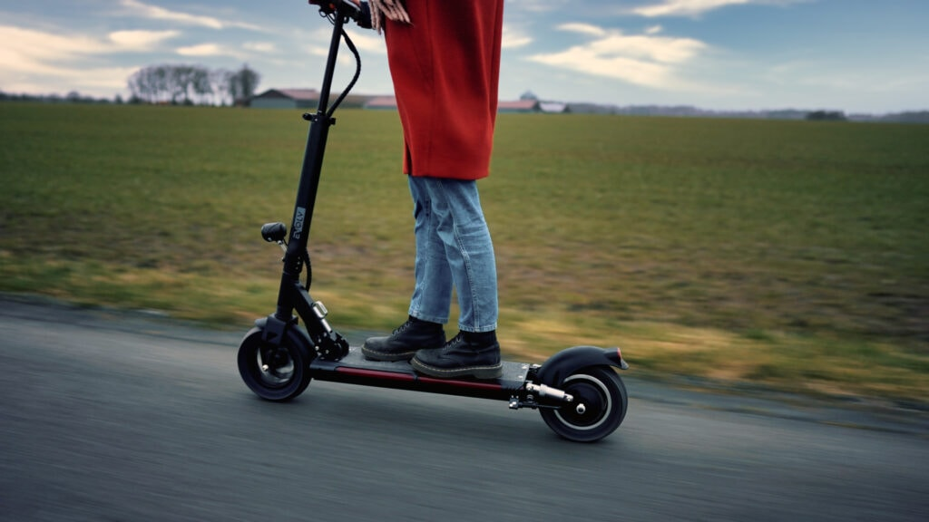 Girl riding on the evolv tour xl-r electric scooter