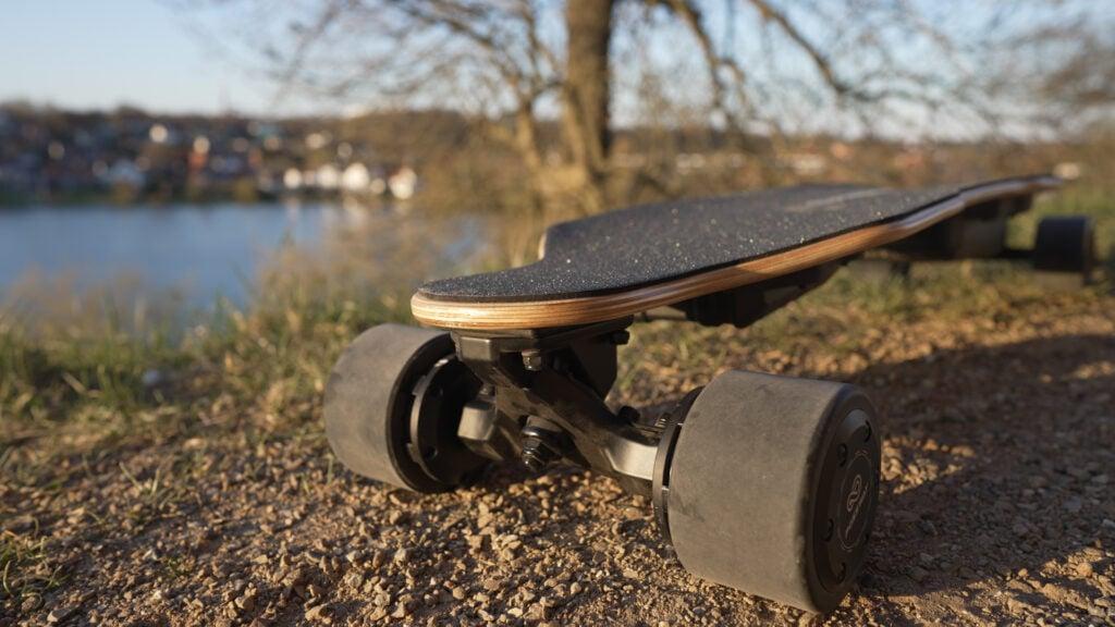 Closeup of electric skateboard trucks