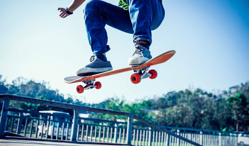 Man riding on a complete skateboard build